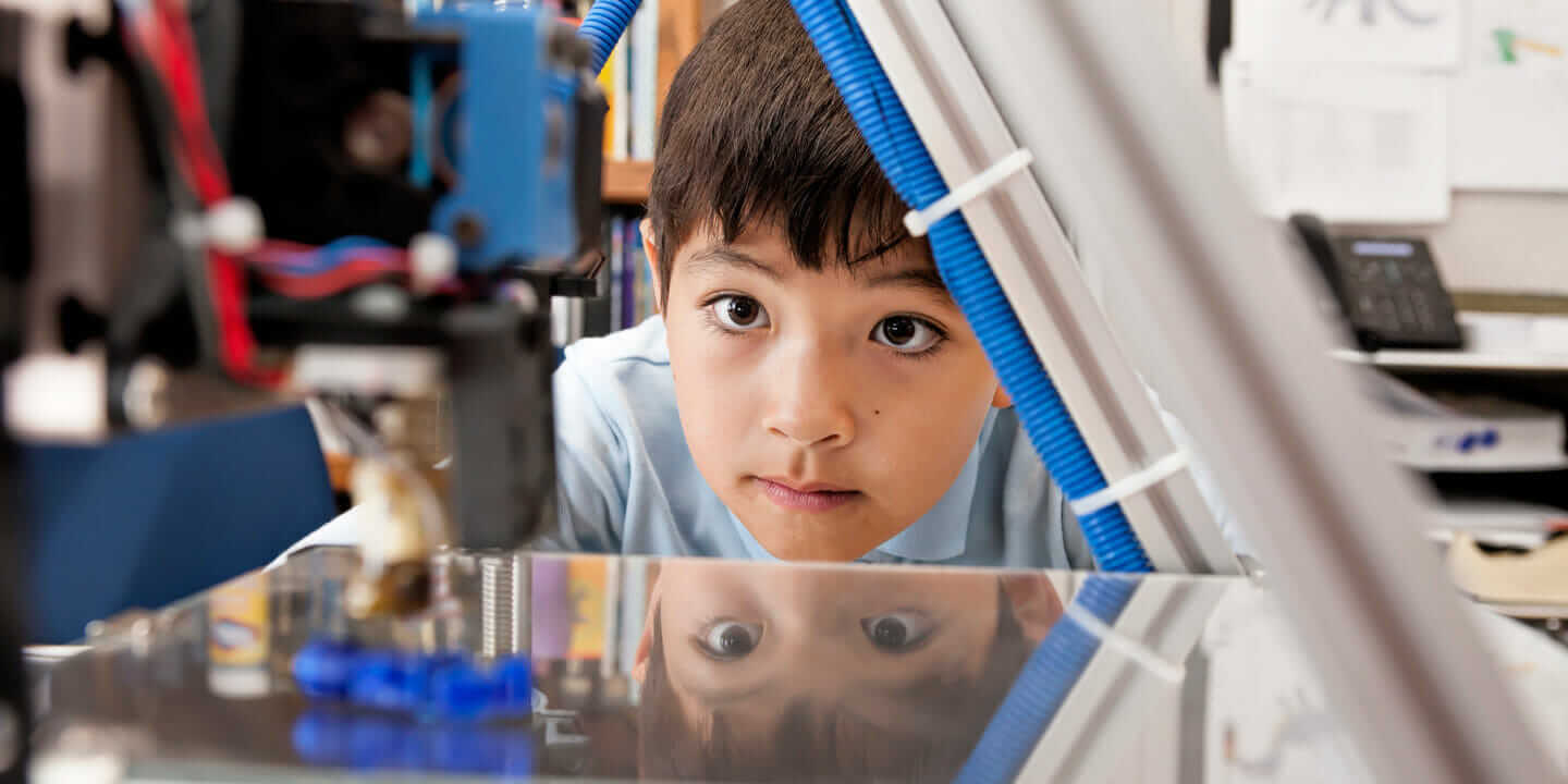 kid watching 3D printer