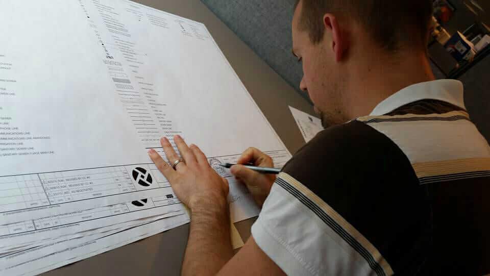 Daniel Iliyn signing roadway plans