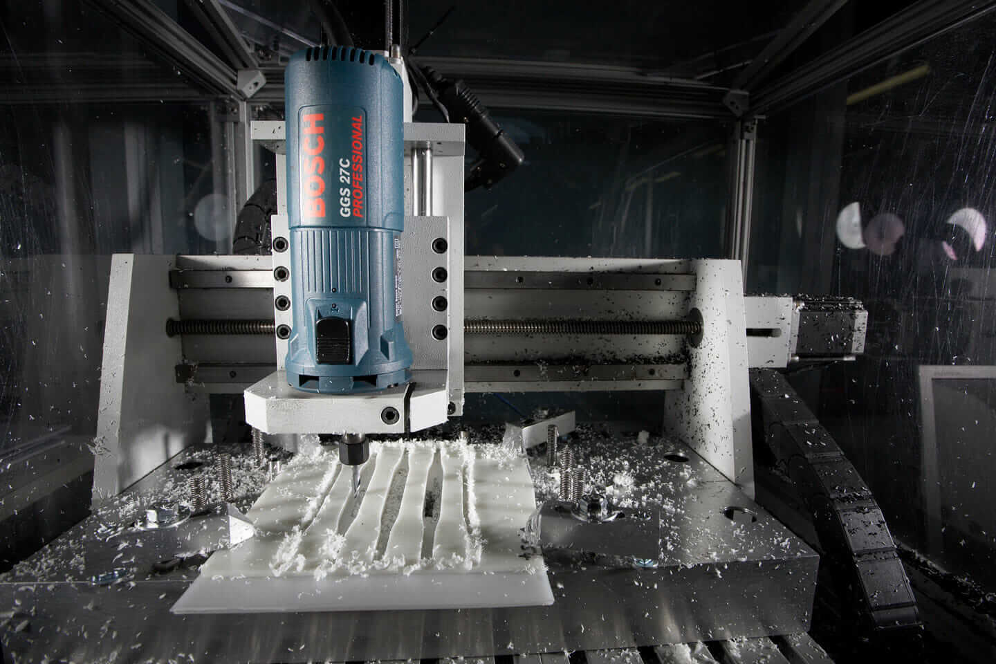 A close-up view of a CNC profile cutter used to cut molded plastic