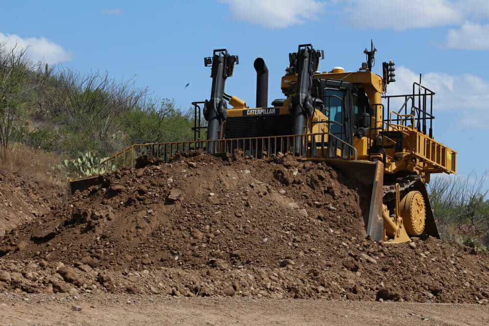 Autonomous dozer pushing dirt pile
