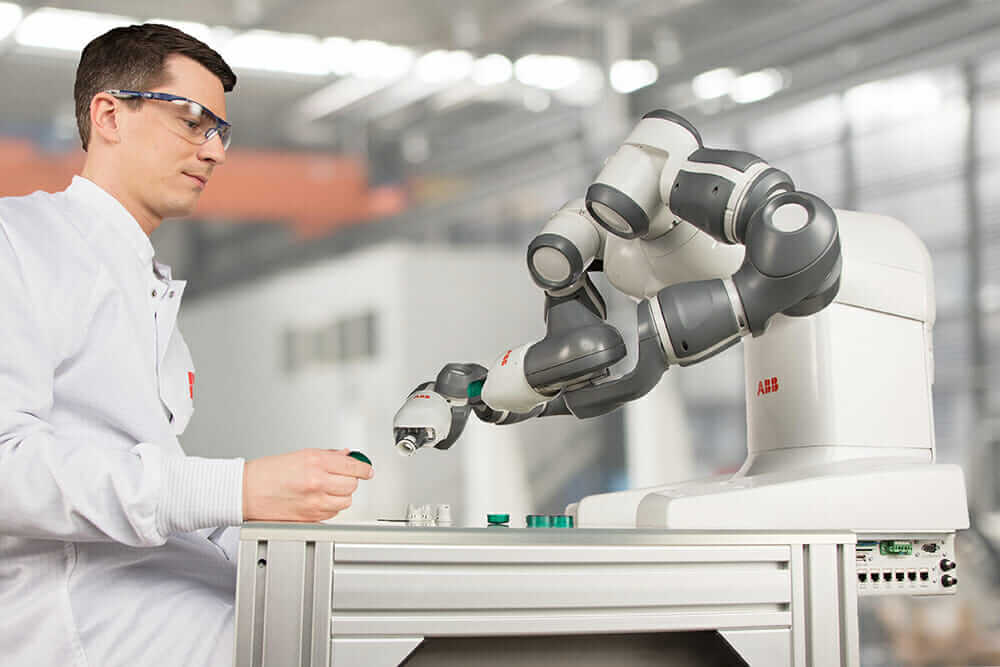 collaborative robots YuMi working with human