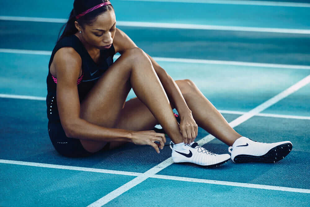 john hoke nike Allyson Felix wearing shoes showing spikes