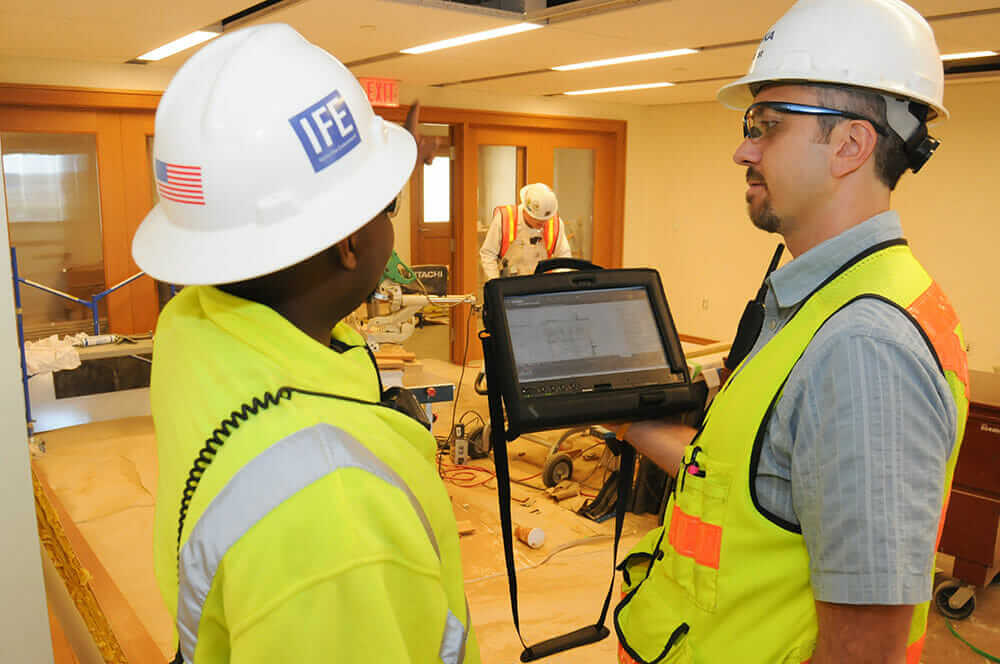 Construction superintendent Lance Borst with colleague and tablet