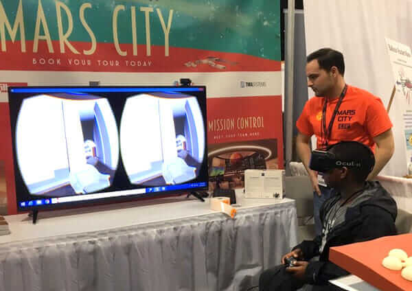 Architect Rolando Lopez and a student getting a Mars City tour at the USA Science & Engineering Festival in Washington D.C.
