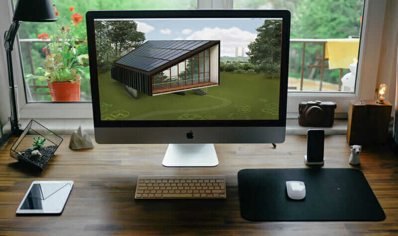 View of a desktop computer with an illustration of a sustainbly-designed home