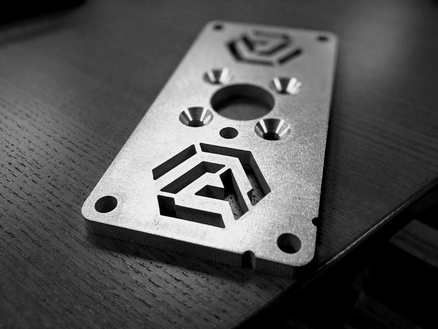 Image of the AMP Robotics logo on a small piece of hardware.
