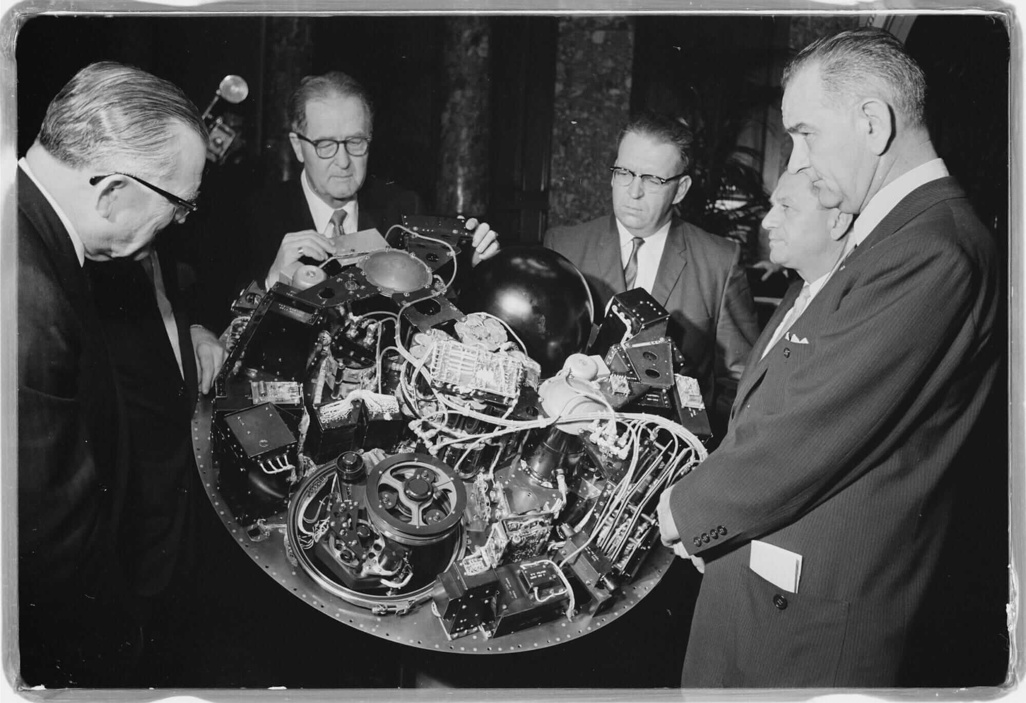 A showing of NASA's TIROS I satellite and its circuitry to Lyndon B. Johnson and U.S. senators on April 4, 1960.