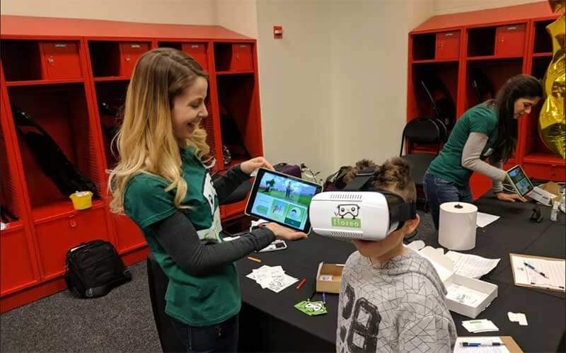 Child testing Floreo's virtual reality in medicine platform.