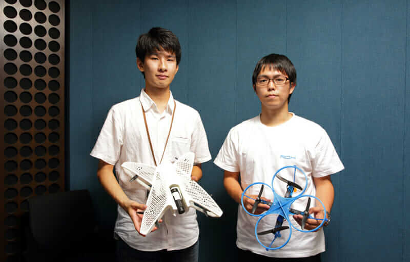 Team ROK's Yuki Ogasawara (left) and Ryo Kumeda (right) won the  the National Student Indoor Flying Robot Contest with the blue drone on the right.