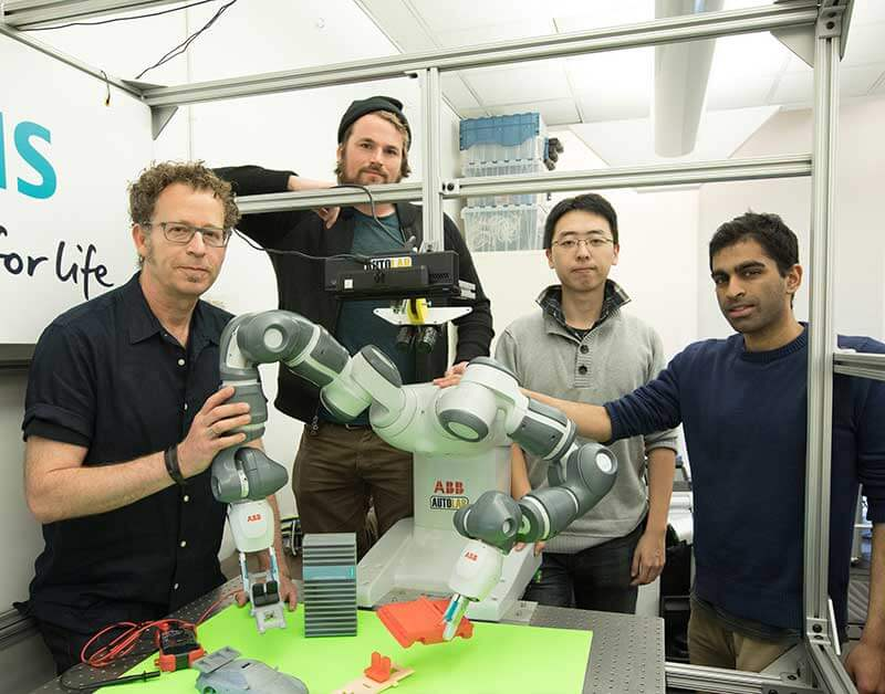 Ken Goldberg (far left) with AUTOLAB research students Michael Laskey, Jacky Liang, and Sanjay Krishnan.