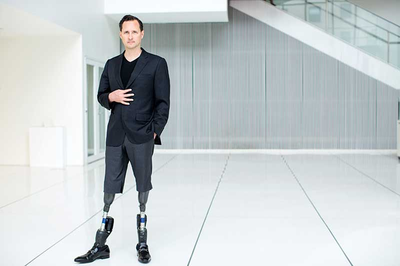 Hugh Herr with robotic legs representing future robot-human synergy