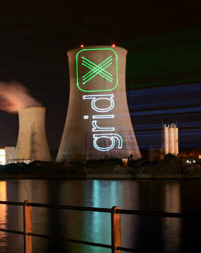 distributed generation gridX protest/publicity stunt laser projection