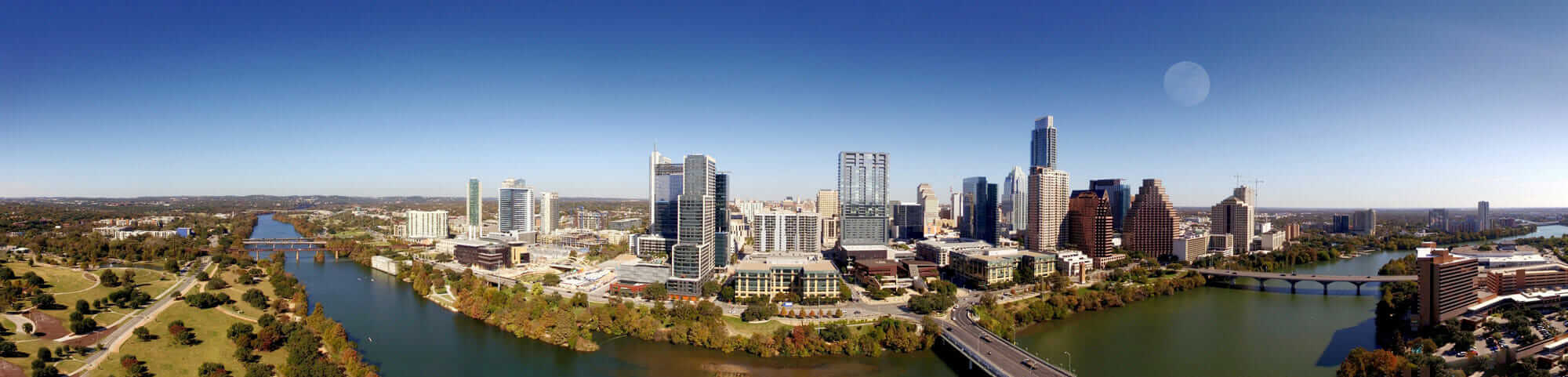 Panoramic view of Downtown Austin, Texas showing bridges and civil engineering projects