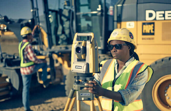 Next generation construction worker using surveying equipment