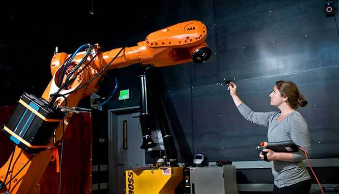 A human manufacturing worker training with a AI-powered counterpart.