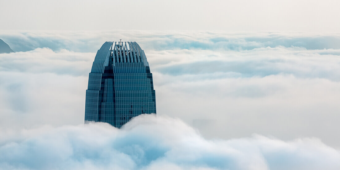A supertall skyscraper's top floors break through the clouds.