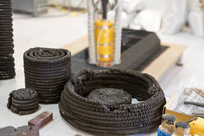 NASA's Swamp Works innovation lab simulates lunar regolith using Black Point 1, a waste product of asphalt production.