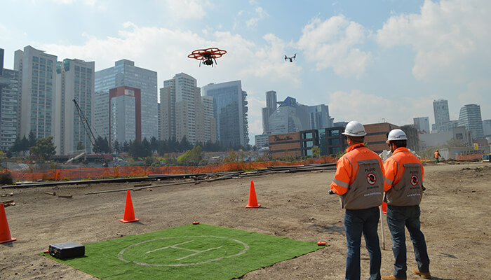 A pair of Consorcio IUYET workers use drones for geolocation.