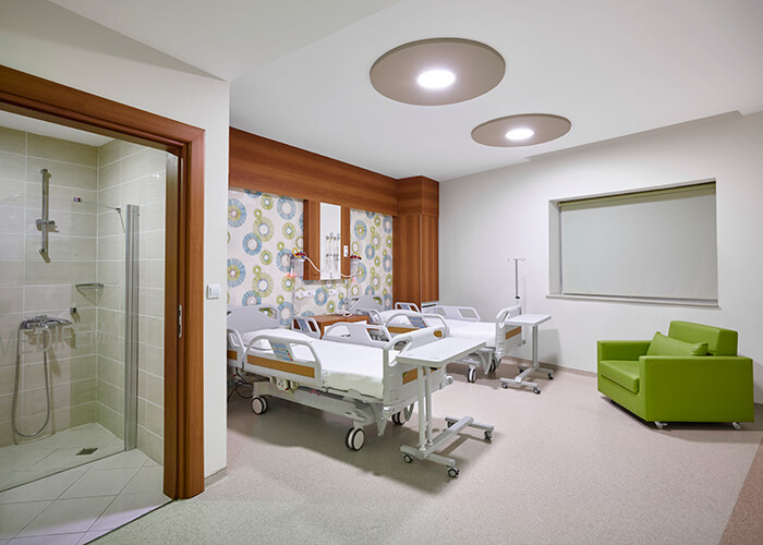 A hospital room designed with comfort in mind.