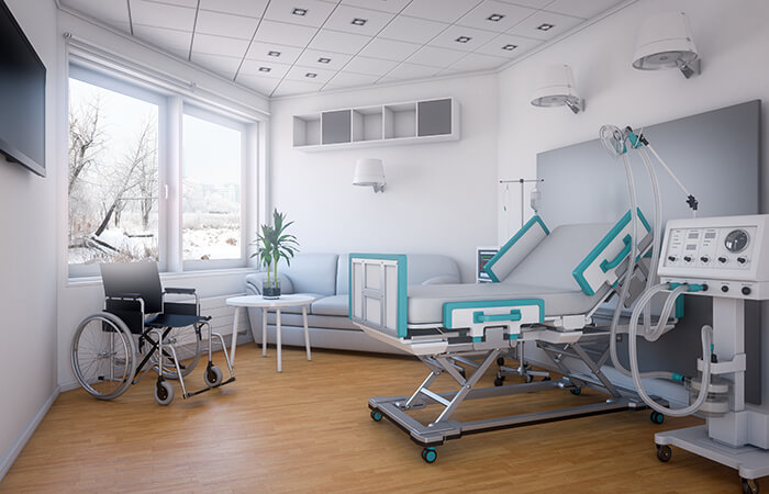 A modern hospital room with ample space and light.