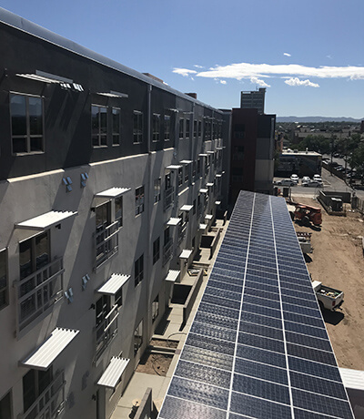 net zero buildings solar-powered water-heating system in carport