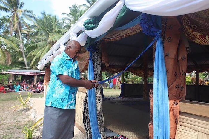 sustainable development in fiji Chief Tui Mali decorates bure vorovoro