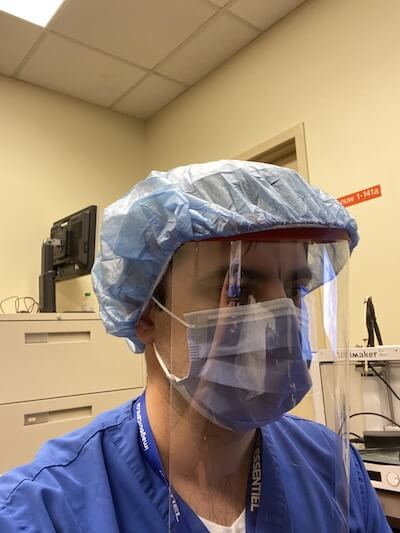 3d printed ppe hospital worker wears face shield