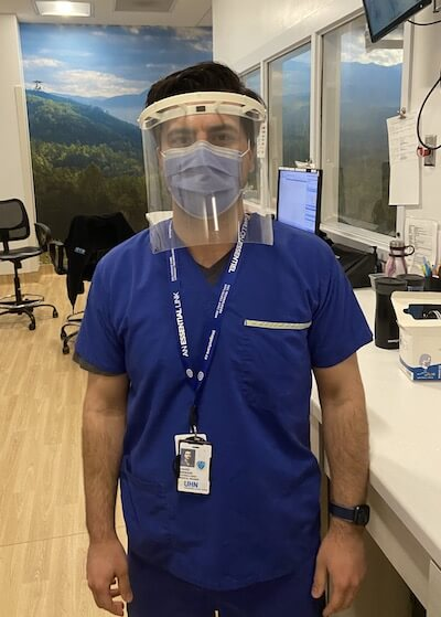 3d printed ppe hospital worker wears apil face shield