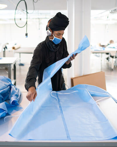 fashion industry waste ISAIC person making PPE