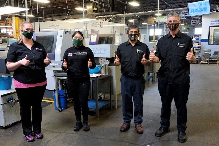 business continuity management pioneer service employees wearing masks