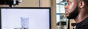 man viewing design software on desktop monitor