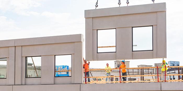 A crew installs precast concrete exterior panels