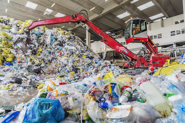 plastic problem crane sorting plastic at recycling center