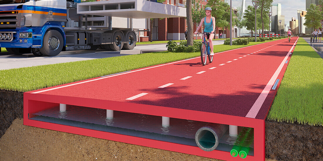 Rendering of road made of plastic, with woman cycling