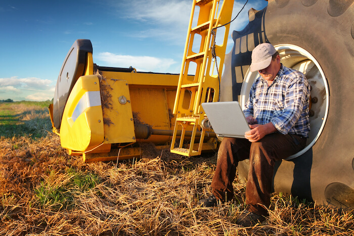 5g in rural areas farmer with computer