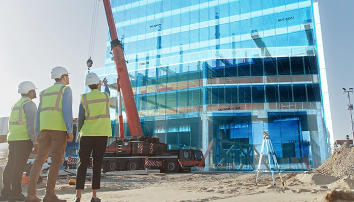 What is a digital twin Construction workers view a virtual building.