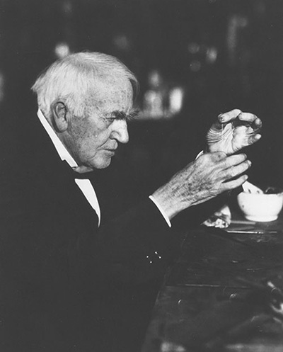 Black and white photo of older Thomas Edison in profile