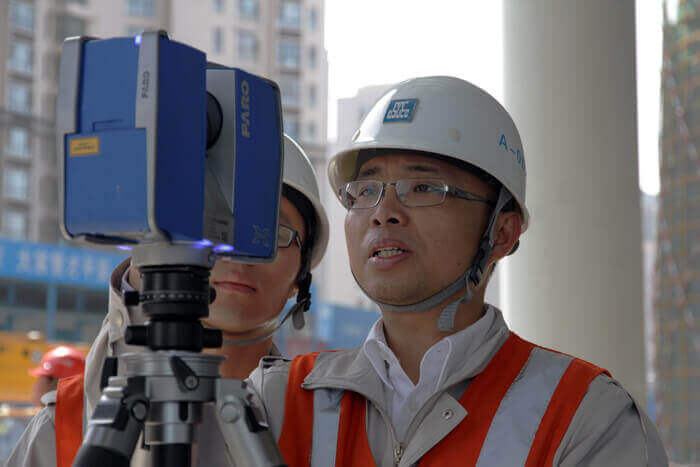 Project manager Su Yawa using laser scanning and BIM to improve construction efficiency and building sustainability