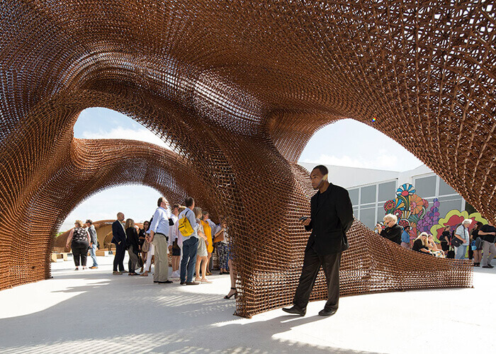 Visitors explore Nashville's 20-foot-tall OneC1TY lattice bandshell structure.