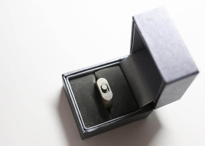 A Interface Jewellery HIJ toggle ring, which has moving parts created by Direct metal laser sintering.