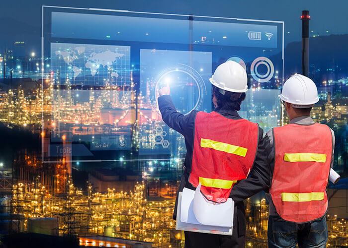Ouvriers sur le chantier connecté du futur