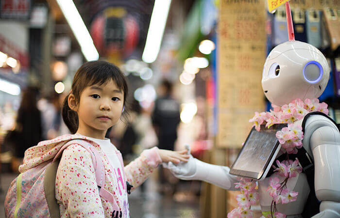 robots in architecture kid shaking robot hand