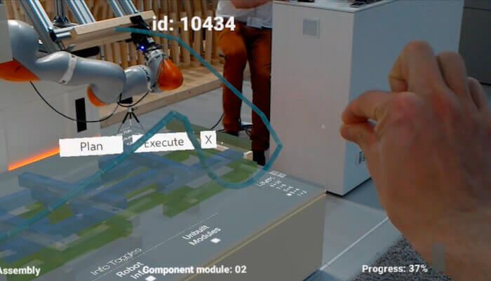 Using an AR headset, the CRoW user can digitally place the next piece of a construction, assessing data and trying alternative positions digitally.