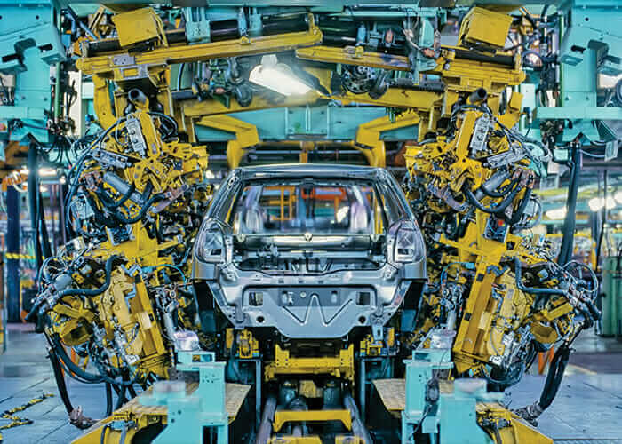 Image of robot workers assembling a vehicle, highlighting concerns that automation will kill jobs