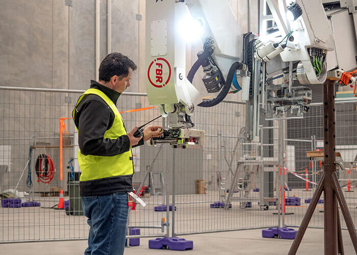 bricklaying robot fbr employee cosimo santella doing dynamic stability testing